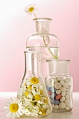 Chamomile flowers and tablets in apothecary bottles