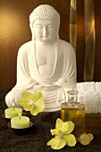 Buddha with orchid flowers and candles