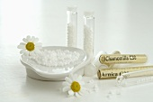 Globuli (homeopathic remedies) with chamomile flowers