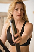 Blond woman working out on crosstrainer