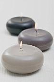 Three burning floating candles