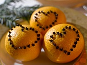 Oranges studded with cloves (heart shapes)