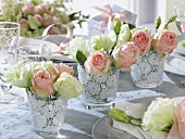 Romantic table decoration with lisianthus and roses