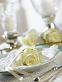 Place-setting with white rose