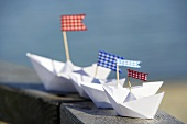 Paper boats with flags