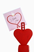 Heart-shaped card holder with card for Valentine's Day