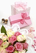 Two gifts, bouquet of flowers and chocolates