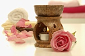 Aroma lamp, pink rose, towels and soap