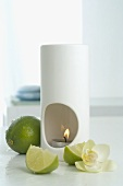 Aroma lamp with limes and orchid flower
