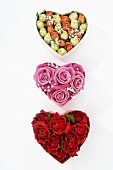 Three heart-shaped boxes filled with roses