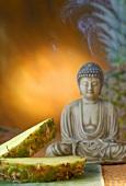 Pineapple and Buddha figure