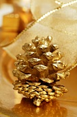 Gilded fir cone on Christmas plate