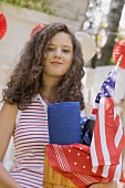 Young woman at a 4th of July garden party (USA)