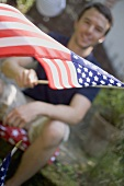 Man waving American flag on the 4th of July