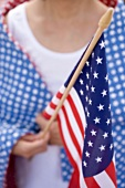 Woman holding American flag (4th of July, USA)