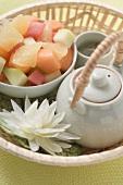 Fruit salad and tea in basket
