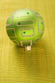 Green Christmas tree bauble with gold decoration