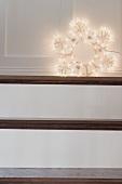 Christmas decoration: illuminated star on stairs