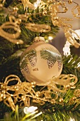 Painted Christmas tree bauble and gold chains