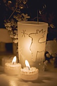Two tealights and windlight with reindeer design