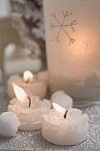 Christmas decoration: three tealights and windlight