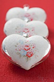 Three silver hearts with rose motifs (Xmas tree ornaments)