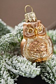 Christmas tree ornament: owl on snow-covered fir branch