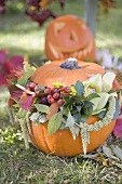 Autumnal garden decoration with pumpkins and flowers
