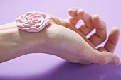 Rose soap on someone's hand