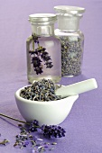 Lavender flowers in mortar and apothecary bottles