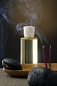 Scented oil, incense sticks and healing stones