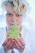 Girl with Christmas tree ornament