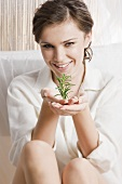 Young woman with rosemary