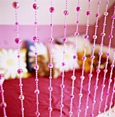 Pink bead curtain in a girl's room