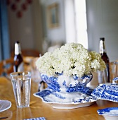 Laid table with white flowers