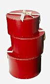 Three red hatboxes