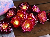 Illuminated artificial flowers