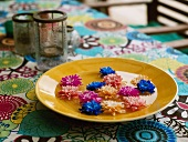 Summer flowers on plate (table decoration)