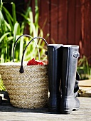 Wicker basket and a pair of galoshes