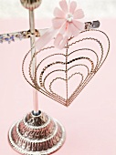 Wire heart with pink flower on stand