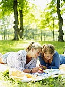 Two women on a picnic blanket
