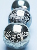 Antique silver Christmas baubles in a row