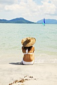 Woman in sunhat by sea (Malaysia)