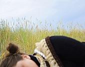 Woman asleep on the beach (Sweden)