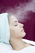 Young woman having steam treatment (spa treatment)