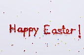 The words 'Happy Easter' in red icing with sprinkles