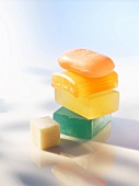 Colourful cakes of soap, stacked, close up