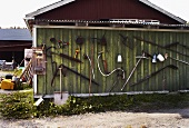 Implements on a shed wall