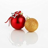 Two different Christmas baubles (red and gold)