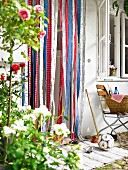 Fly curtain of colourful fabric strips in garden door